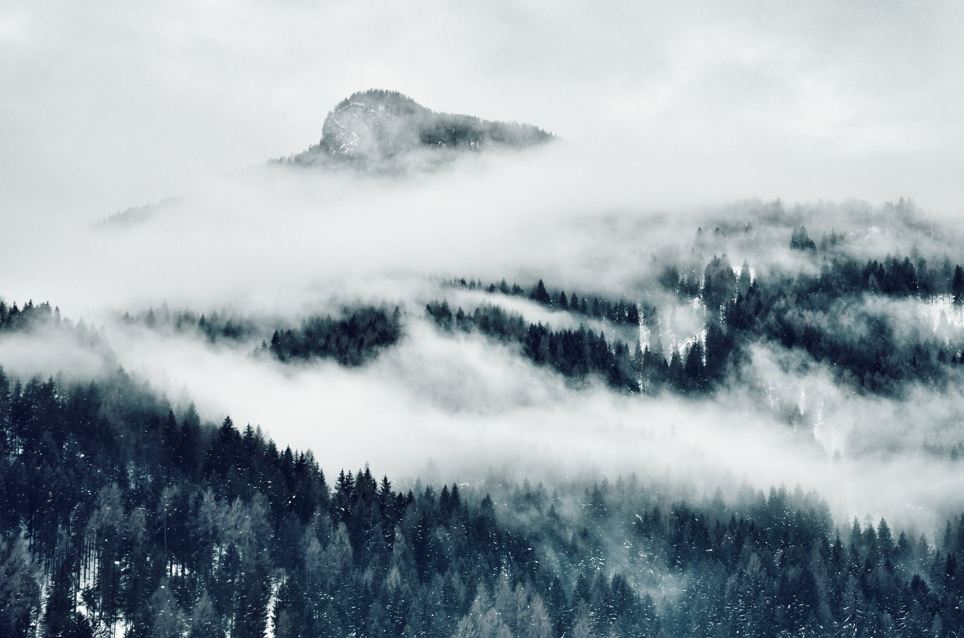 high angle photo of mountain cover with clouds